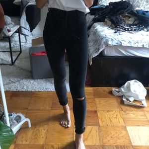 Black jeans with knee slits